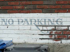 no parking painted sign westmountmag.ca