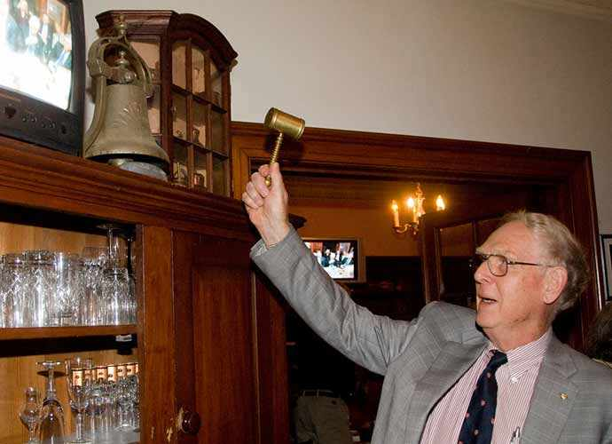 Last WN salon at 33 Rosemount – Gerald Razter ringing the USS Mayflower ship's bell - WestmountMag.ca