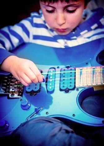 boy playing guitar - WestmountMag.ca