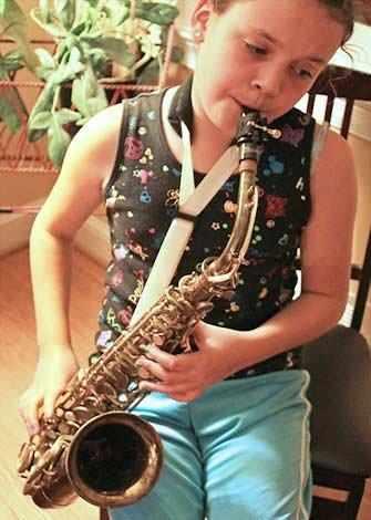 girl playing saxophone - WestmountMag.ca