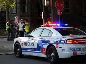 Police ticketing cyclist - WestmountMag.ca